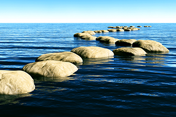 Path of stones on the ocean representing Investment Management